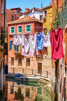 Canal and drying linen outdoor in Venice