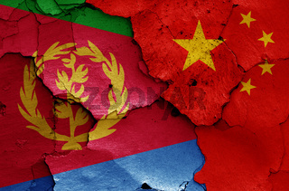 flags of Eritrea and China painted on cracked wall