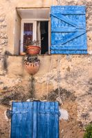 Country house with blue shutters in the Provence