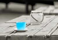 Colorkey, Cup on the table of a beach bar in Magdeburg in Germany