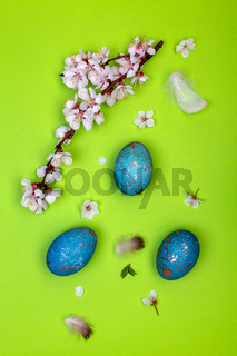 Background with Easter eggs and a flowering branch.