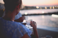 Couple drinking tea on shore in evening