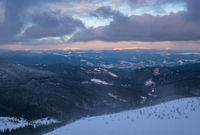 Picturesque winter alps windy day sunrise. Panoramic mountains view from Svydovets ridge and Dragobrat ski resort.