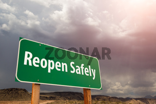 Reopen Safely Green Road Sign Against Ominous Stormy Cloudy Sky