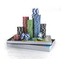 Stacks of poker chips on a book. Poker education.