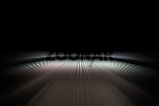 Streaks of light on night road. Abstract background of light lines. Perspective of luminous stripes.