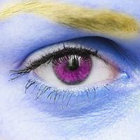 Female eye and blue skin with a yellow eyebrow. Fashionable and stylish design. Creative style, art gallery.