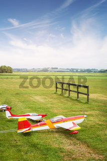 Model airplanes ona line on a green field