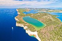 Telascica nature park cliffs and green Mir lake on Dugi Otok island aerial view