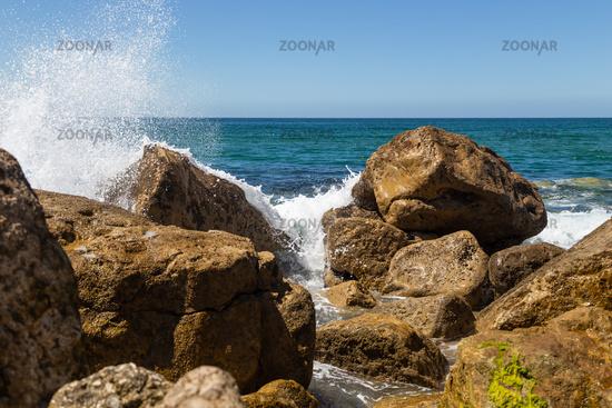Splashes from a wave splashing on the rocks