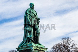 Side view on Monument of Karl Friedrich von Baden with blue sky in background. Near Castle Karlsruhe, Baden-Wuerttemberg, Germany