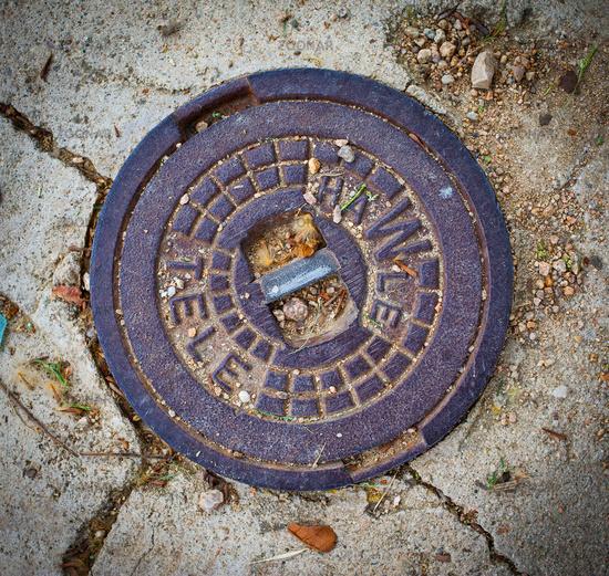 manhole cover in Tossa de Mar, Catalonia, Spain