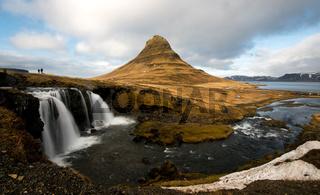 Kirkjufellsfoss waterfalls and Kirkjufell mountain in Iceland