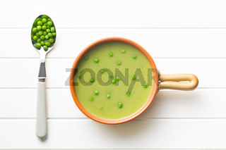 pea soup and peas in spoon