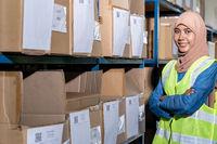 Islam Muslim female warehouse worker portrait in warehouse