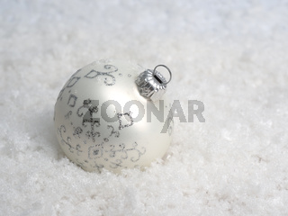 White Christmas bauble in snow