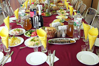 Festive table with delicious dishes. Many food on table for family holiday. Banquet table with delic