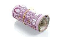 Money roll of Euro banknotes, 500 Euro on top, isolated on white background. Saving, insurance, wealth concept