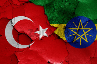 flags of Turkey and Ethiopia painted on cracked wall