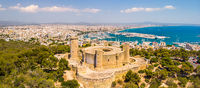 Aerial drone view of Palma de Mallorca city. Cityscape with view on Bellver castle, sea, marina