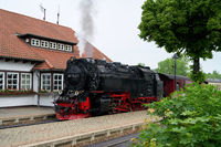 Locomotive and carriages of the Brockenbahn in the Westerntor station in Wernigerode