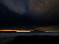 Panoramic foggy landscape with mountains in morning. Landscape