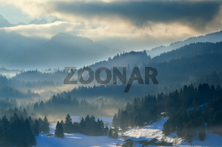misty sunset in Alps