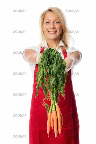 housewife presents a bunch carrots