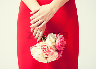 woman hands with flowers and ring