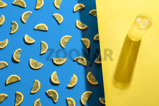 Glass of lemonade and lemon slices pattern. Summer cold drink