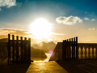 Amazing landscape with an open gate at sunrise