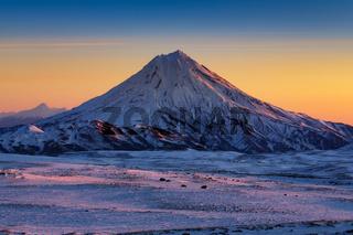 Stunning winter mountain landscape of Kamchatka Peninsula at sunrise