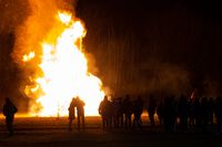 flames and fire released by a pyre for the traditional epiphany festival in Italy