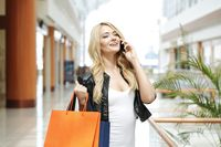 Woman with shopping bags and phone