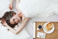 Girl having breakfast in bed