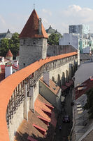 Medieval town wall of Tallinn with roofed guard's walkway and Hellemann tower