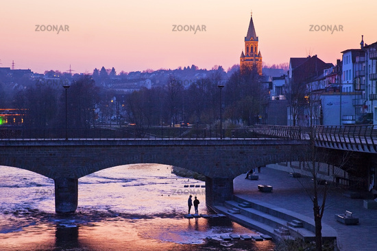 River Lenne with the church tower of St. Kilian in the sunset, Iserlohn, Germany, Europe