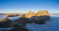 Aerial panorama of cloud sea at Sella mountain pass between the provinces of Trentino and South Tyrol, Dolomites
