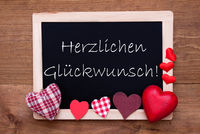 Balckboard With Red Heart Decoration, Text Glueckwunsch Means Congratulations