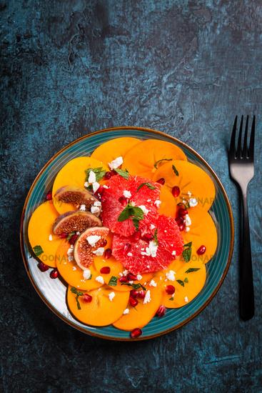 Healthy winter salad - Persimmon carpaccio salad with pomegranate