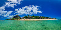 Wonderful view at a tropical island as panorama as an image travel photo. Turquise warm water in front as a panoramic total view.