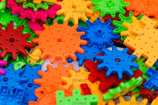 The children's designer. Colored plastic blocks of the designer on the table. Children's designer for the development of motor skills, thinking and imagination.