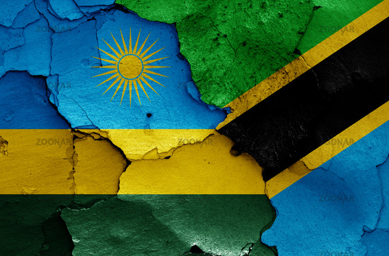 flags of Rwanda and Tanzania painted on cracked wall