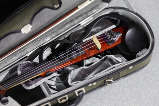 Electric violin in a case