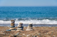 Stack of stones on Petra tou Romiou or Aphrodite Rock Beach, Cyprus