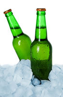 Two bottles of beer on ice isolated