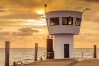 Lighthouse at Dagebuell Harbor at Sunset, North Frisia, Germany