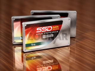 Generic SSDs standing on wooden table. 3D illustration