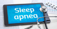 The word Sleep apnea on the display of a tablet