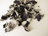 Fermented and dried blackberry leaves for caffeine free black tea on a wooden board